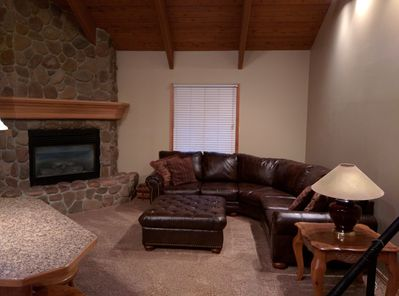 Living room with sectional and gas fireplace