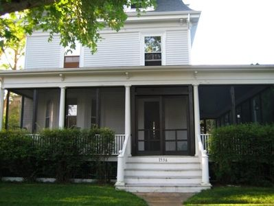 Photo for Historic three-story, mansard-roof house with 600 sq ft screened-in porch.