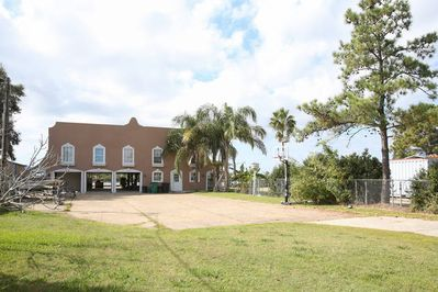 Enormous gated front yard with basketball goal,