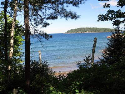 Quiet, isolated oasis on 300 feet of Lake Superior beach and 10 wooded acres.