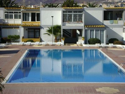 Photo for Simple and comfortable apartment with pool, gardens and parking area