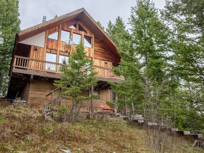 Photo for Rustic and charming two bedroom cabin with a hot tub - Bridger Bowl Ski area.