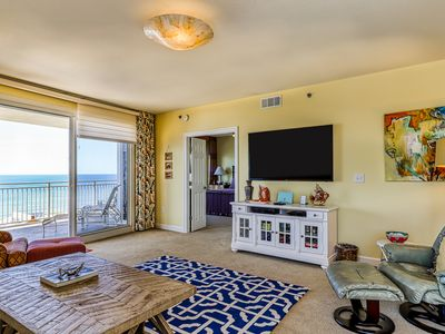 Photo for Community pool, grills, fitness center - all in a building on the beach!