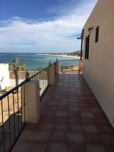 Photo for Enjoy gorgeous sunrises + private pool just steps from the beach.