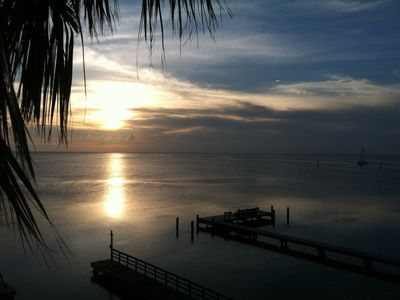Photo for Spectacular Sunsets on the bay, two balconies, night fishing and boat dock