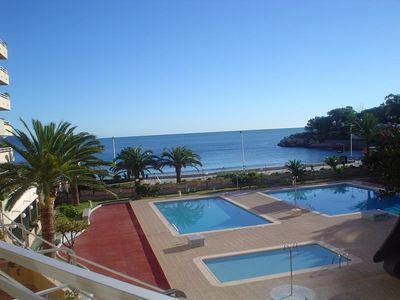 Photo for Apartment on the beachfront, front view to the sea, swimming pools, tennis