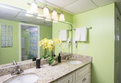 Gorgeous remodeled bathroom. New Quality Cabinets & Granite  Counter Tops!