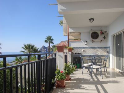spacious and furnished sea-front terrace