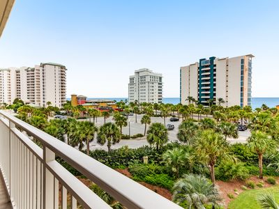 Photo for Magnificent waterfront condo w/private balcony, shared pool, gym, & snack bar!
