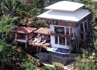 The gorgeous villa is surrounded by lush rainforests.