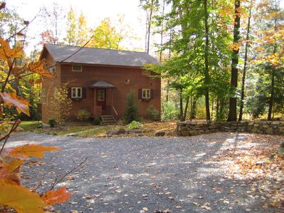Long driveway and large level yard with ample parking.