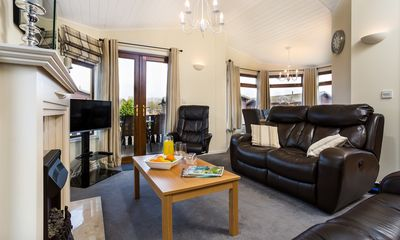 Photo for Luxury Lodge with shared Pool and free in lodge WIFI