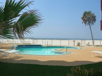 Relax by our beach side pool.  Lots of chairs around the pool