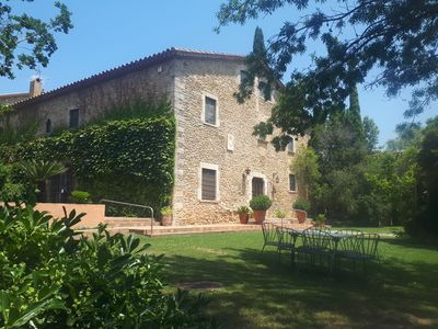 Photo for Authentic Catalan farmhouse for 16 to 24 people. Garden with pool, barbecue, ..