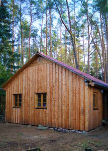 """Photo for The holiday home """"Ortheide 69"""" is located in a forest settlement with high trees."""