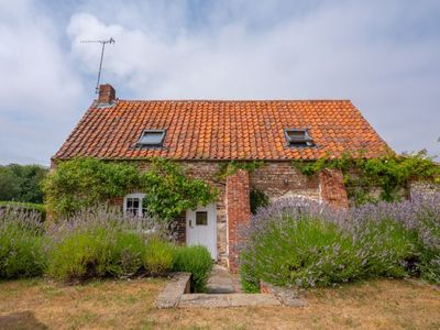 Photo for A picturesque country cottage, over 200 years old, in an idyllic rural position.