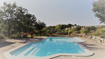 Photo for Charming country house, 11 people, heated pool, Pyrenees view, near Carcassonne