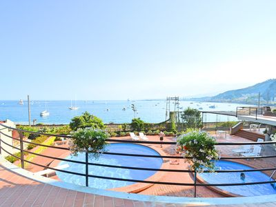 Photo for Taormina Mare Holiday House - apartment in residence with swimming pool and communal garden facing t