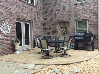 PRIVATE PATIO WITH GRILL AND SEATING