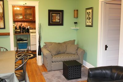 Comfy twin sofa bed adjacent to dining area provides additional sleeping option.