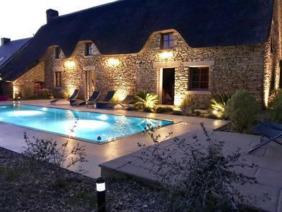 Photo for Authentic charming cottage with heated swimming-pool close La Baule