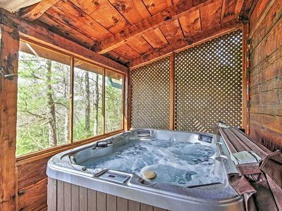 The hot tub is covered and screened in, so you can enjoy it in any weather.