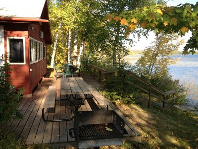 The deck is right along the lake shore. Enjoy the table/chairs or picnic table.