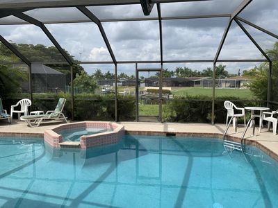 Photo for Canal Front Home, heated  private pool/spa; deep sailboat canal access to Gulf!