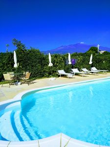 Photo for Apartment with terrace and private garden overlooking Etna, swimming pool