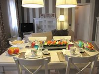 The apartment was beautifully furnished in shabby-chic, with plenty of space in the kitchen, living