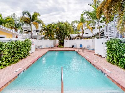 Photo for Charming condo w/ shared pool, Gulf views & great location - walk to the beach!