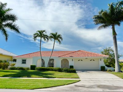 Photo for House on quiet street w/ heated pool & easy access to shopping & beaches