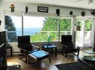 Seacliff living room with picture window, and sun deck.