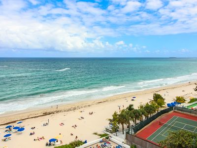 Photo for BEACHFRONT 2 BEDROOM CONDO WITH BIG BALCONY , POOL AND TIKI BAR ON THE OCEAN!!!