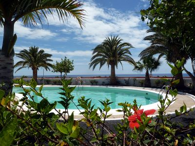 Photo for Refurbished, Poolside Apartment, Atalaya Complex, 3 mins to seafront, wifi UK TV