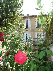 Photo for Spacious apartment on the 1st floor of a beautiful stone house, in the heart of Lectoure ..