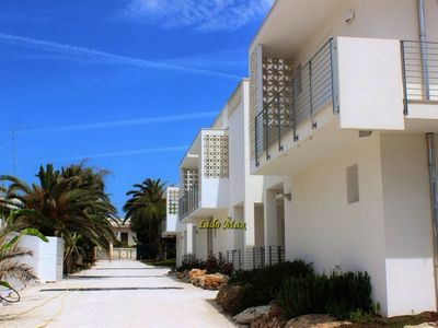 Photo for Modern apartment in holiday complex with private beach - Lido Max – Mono7