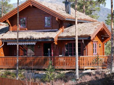 Photo for Cozy cottage + canoe. Central location to the lake + skiing. WLAN, Deut. TV