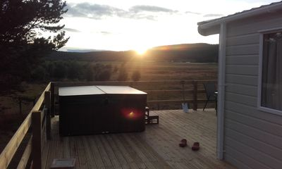 Photo for A  2016 model chalet with  'JUNO hot tub and beautiful unobstructed views.