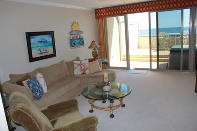 Spacious family room with flat-screen TV and ocean view.