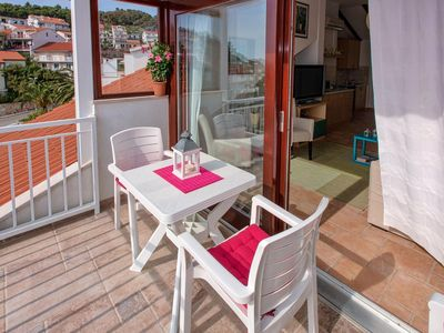Photo for One bedroom apartment with terrace and sea view Hvar (A-11427-b)