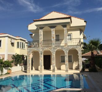 Photo for Beautiful  4 bedroom family villa with pool. Gated secure garden and free wifi