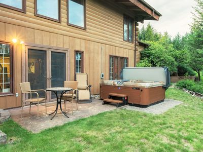 Photo for Dog-friendly lodge w/ hot tub, deck, & 11 wooded acres - drive to Flathead Lake!