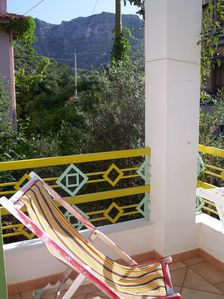 Photo for Apartment with 1 air-con. WI-FI. 400 meters from the sea-mountains.Some garden.