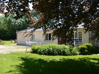 Idyllic, peaceful, yet near to all amenities and wonderful hosts.