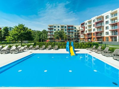 Photo for Holiday apartment with pool and gym
