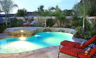 Beautiful in-ground pool with raised jacuzzi