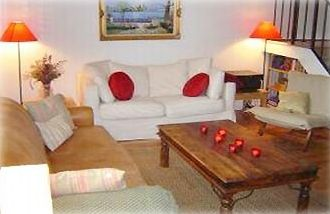 Relax in our cozy and nicely furnished living room.