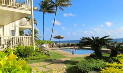Photo for OCEAN FRONT VIEWS - FABULOUS SUNSETS - END UNIT - AIR COND - BEST POIPU LOCATION