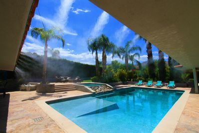 California Misters surround the pool and cool the air by 20 degrees in summer!